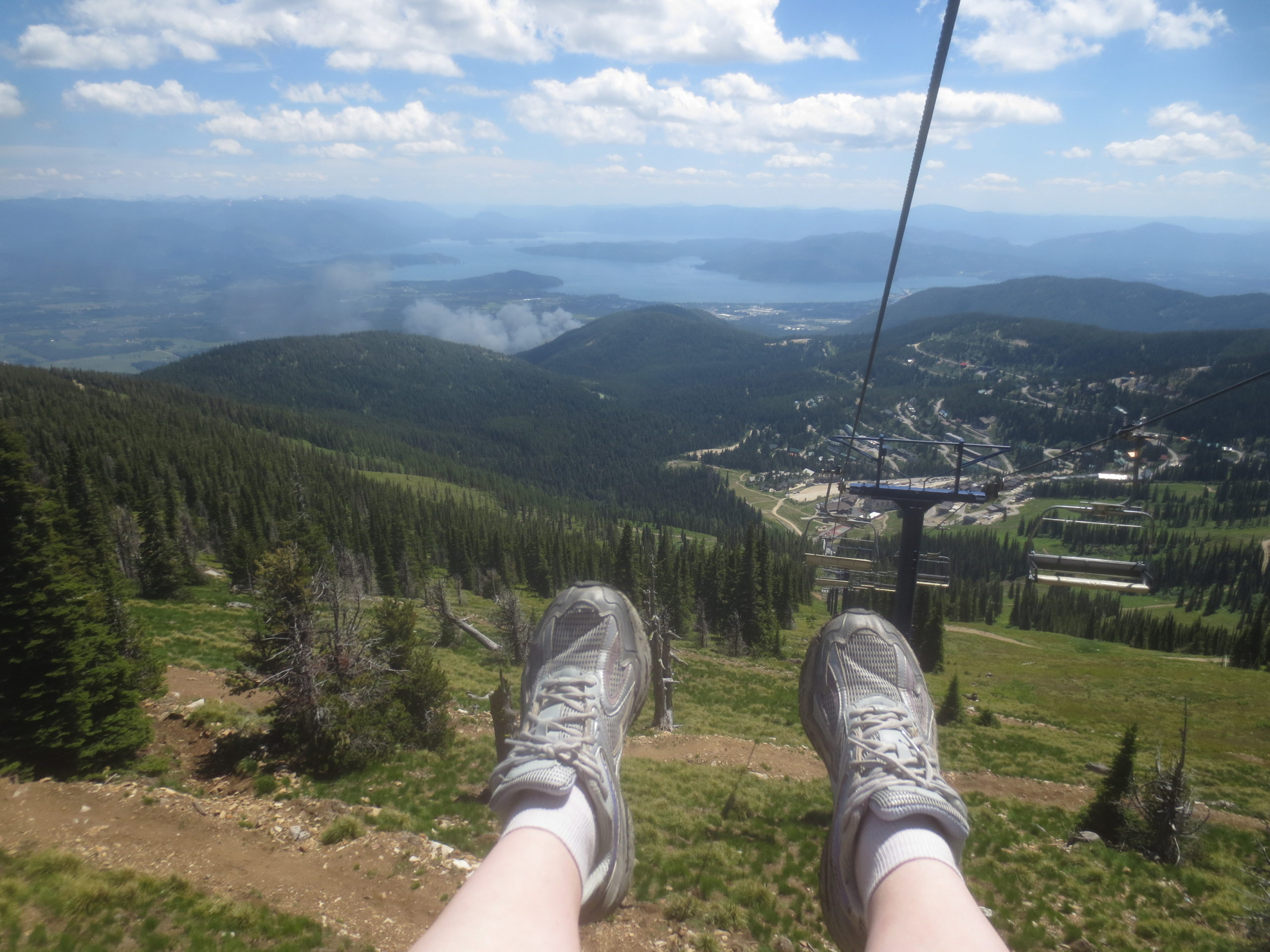 riding down a chairlift in summer