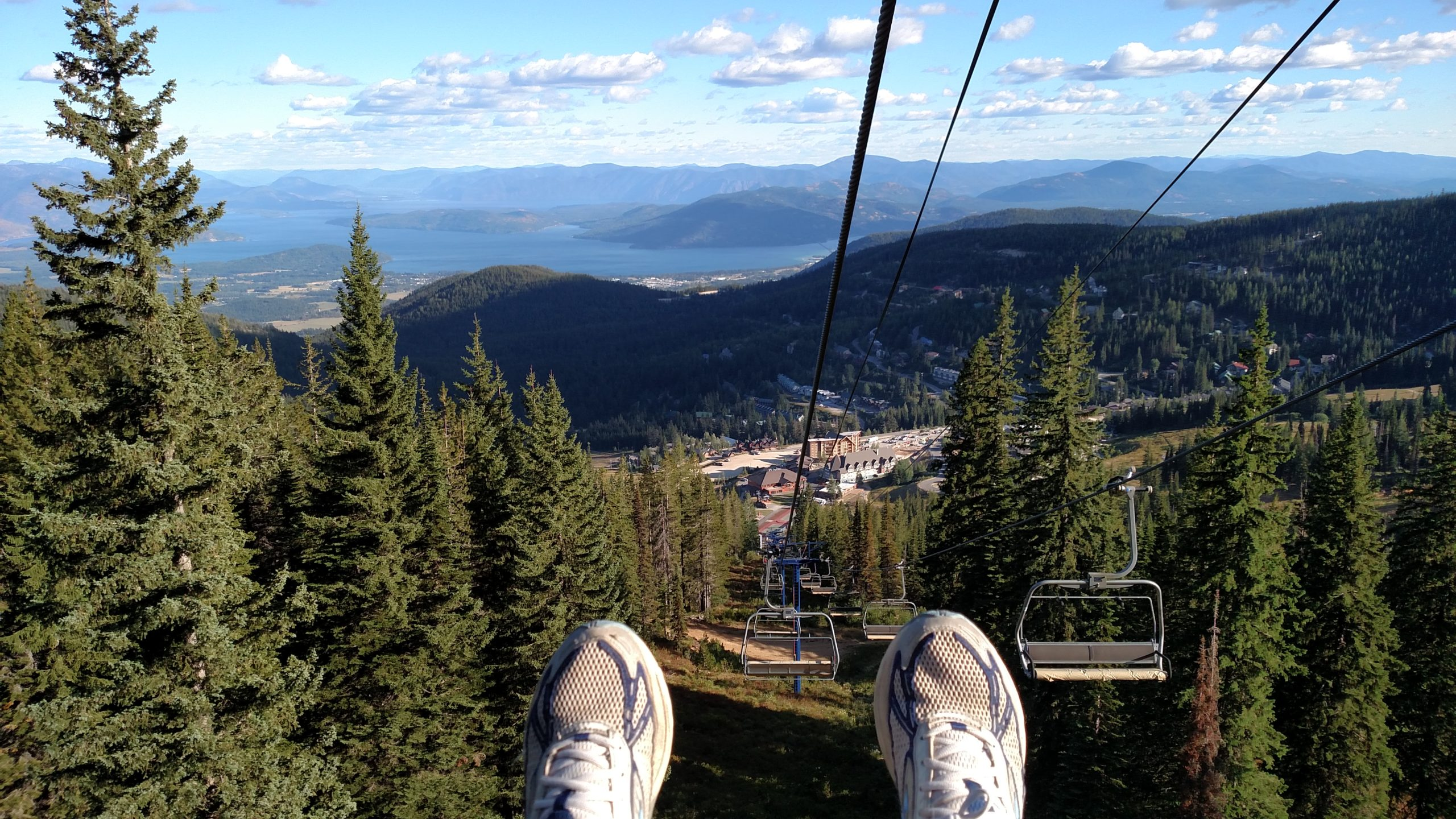 view from riding down a ski lift in summer
