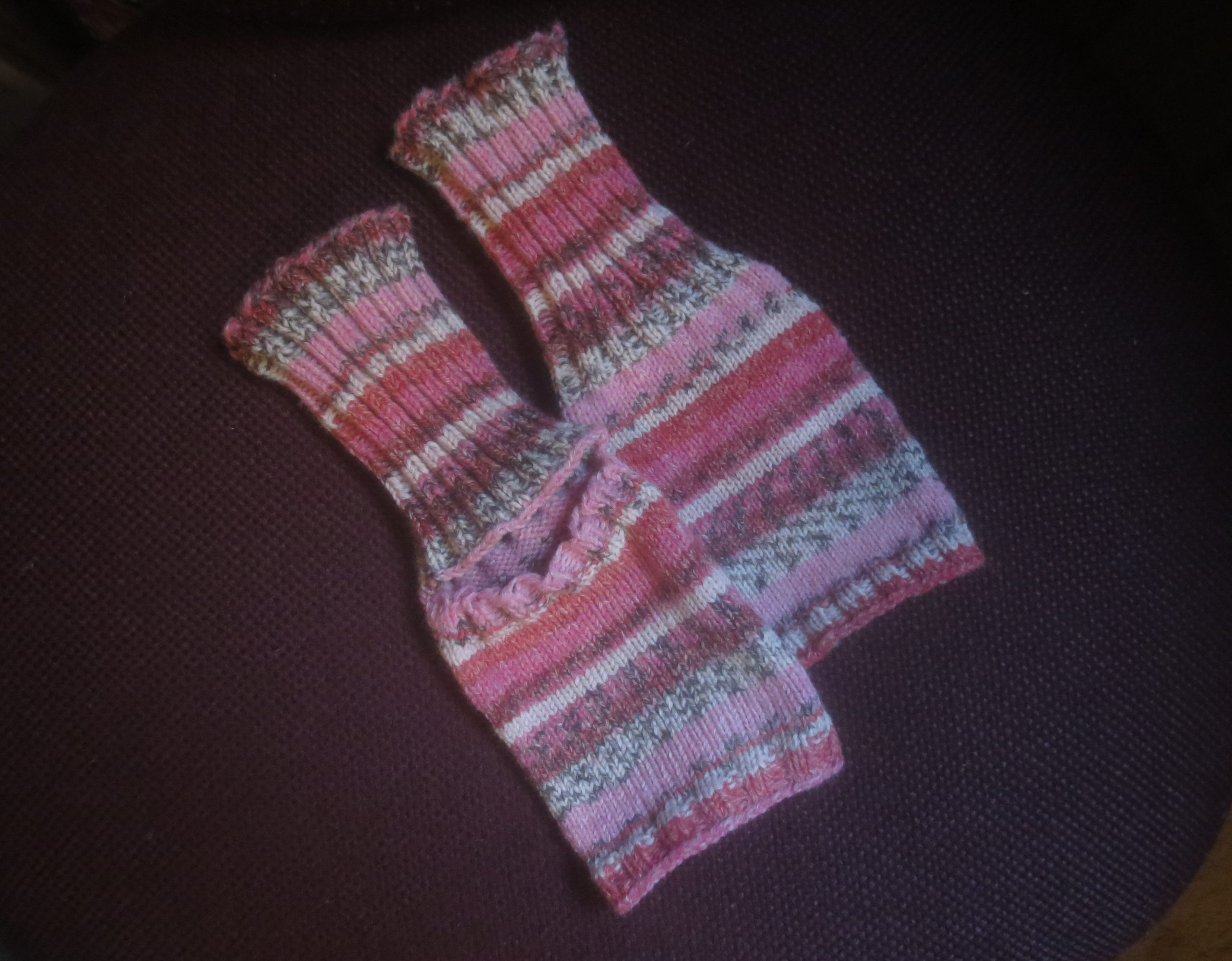 hand knit yoga socks in striped of pinks and creams and greys