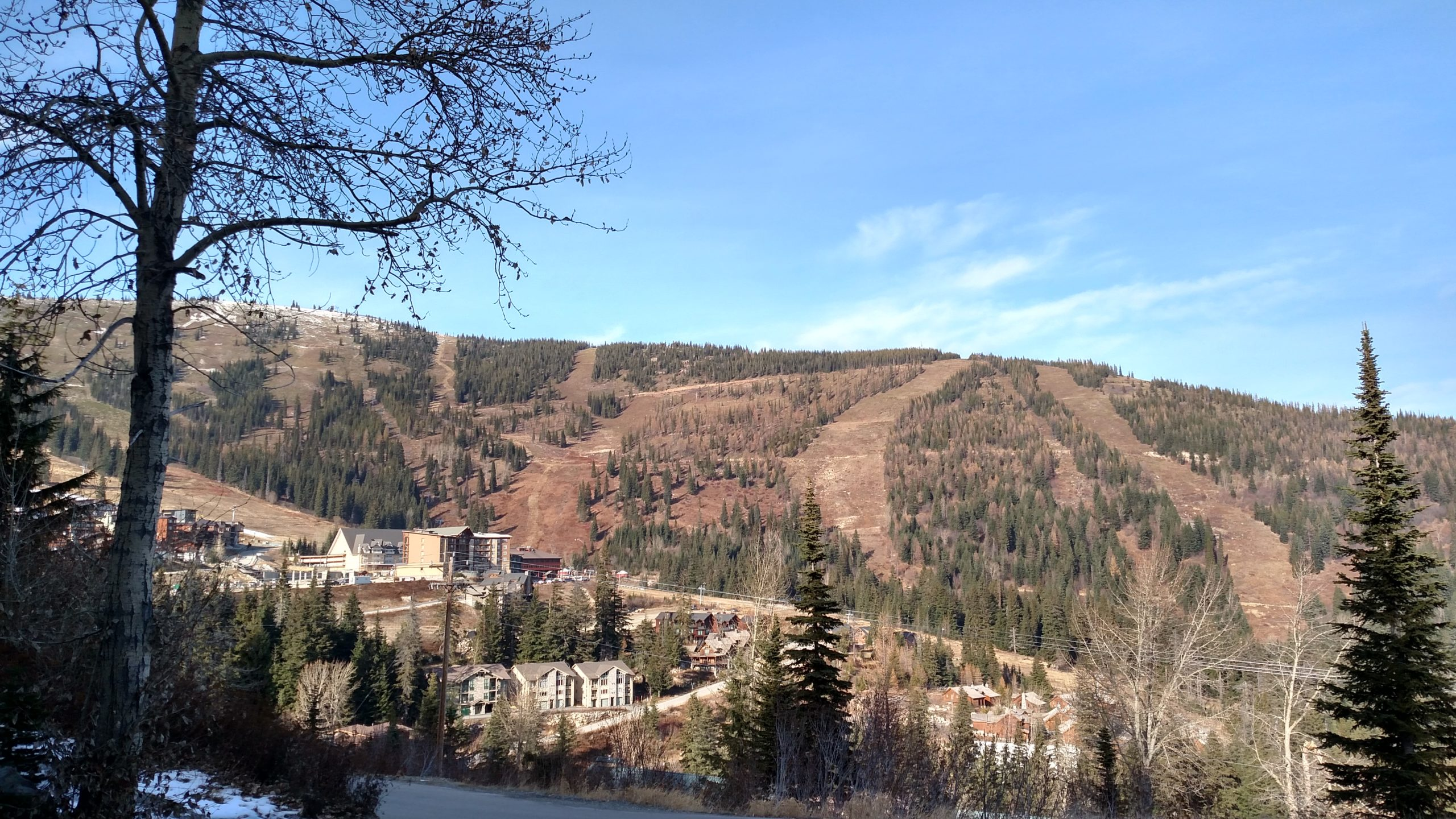 View of a mountain with ski runs that are not yet covered in snow
