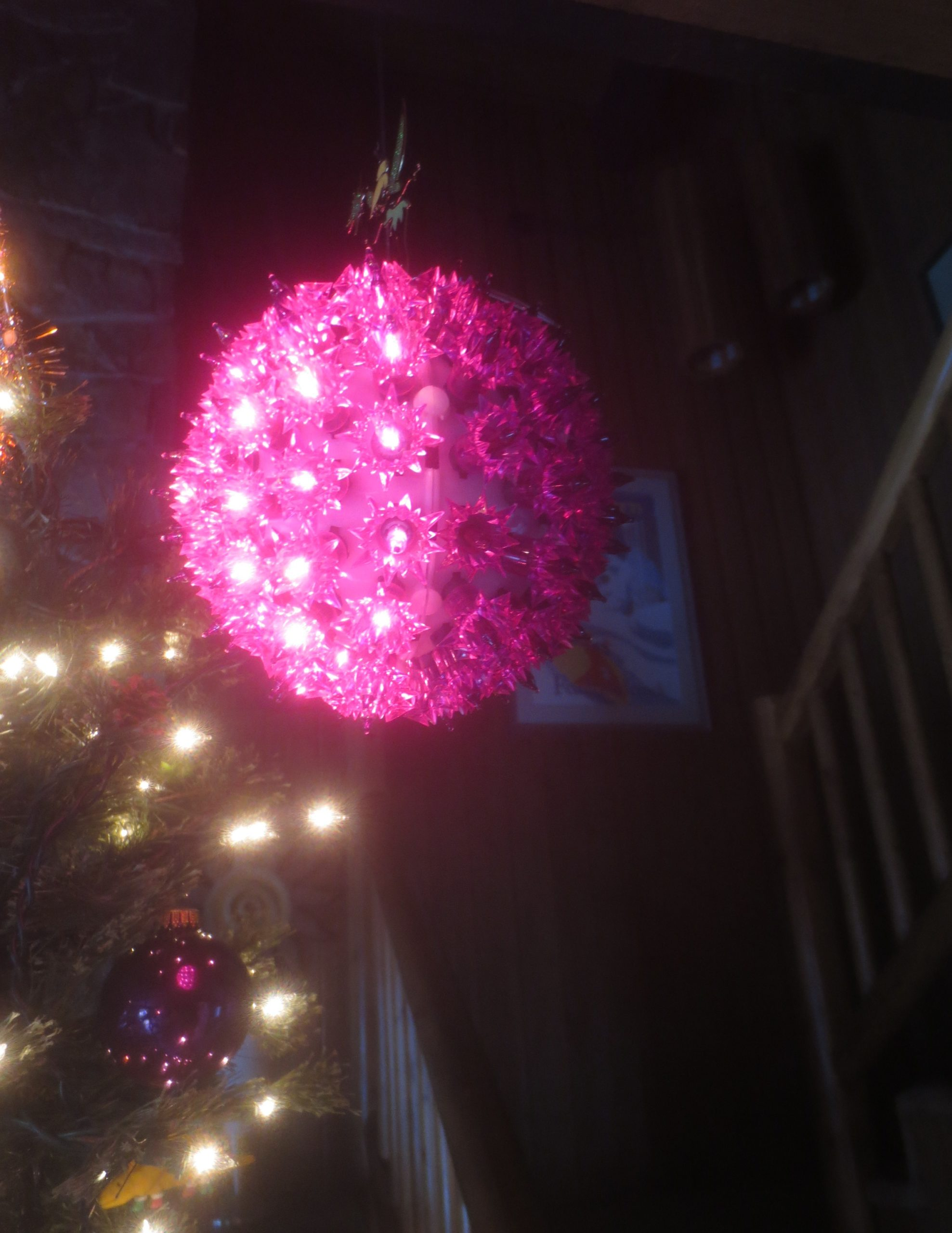 purple ball made form Christmas lights, half-lit