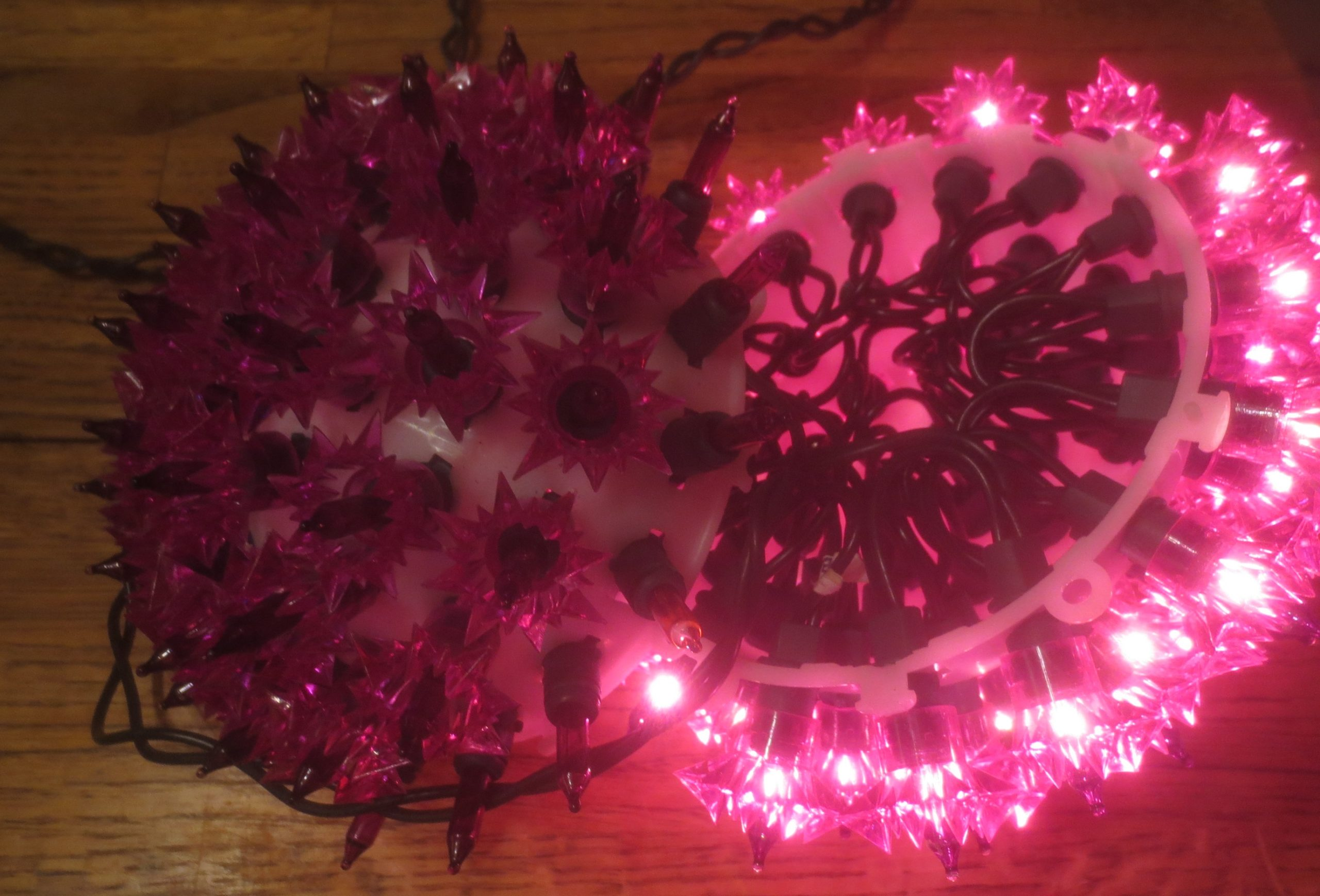 purple ball made form Christmas lights, partially disassembled