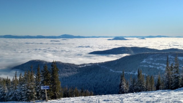 view from a ski hill above the clouds